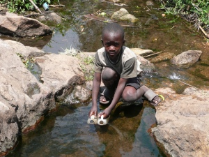When a UNICEF well broke down village people had to walk several km to fetch daily water from this creek.