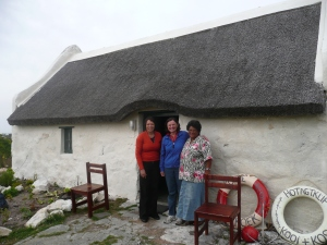 Maryna and Sophia in front of a fishermans cottage very near the Southern tip of Africa.