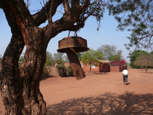 Hanging from this tree is the Church/school bell used to call the village to school and services since most don't have watches.